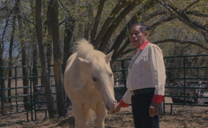 long-term pancreatic cancer survivor Jose Lucero and his white horse