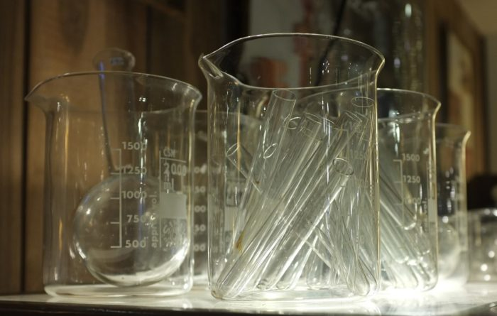 clear laboratory glassware including beakers and flasks