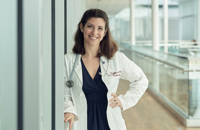 Pancreatic Cancer researcher Dr. Kim Reiss Binder in her white coat with a stethoscope, standing in a hallway discussed PARP inhibitors