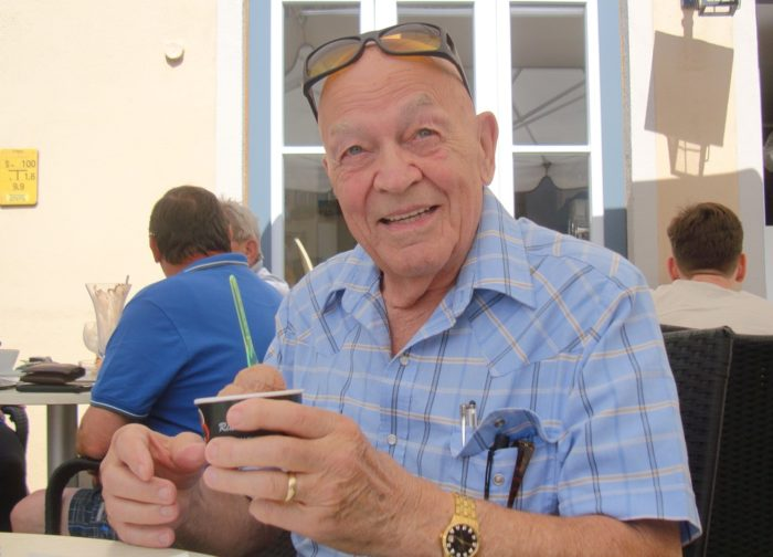 Long-term pancreatic cancer survivor Bob Harris eating ice cream outdoors