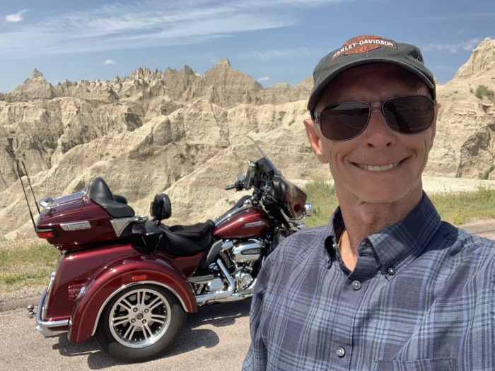 Pancreatic cancer survivor Ken Vickers and his Harley in the Badlands of South Dakota