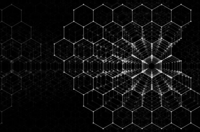 white 3-d hexagons on a black background