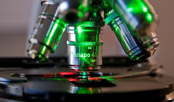 close up of microscope with green and red lighting
