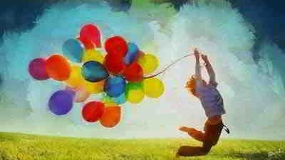 child filled with joy over his balloons