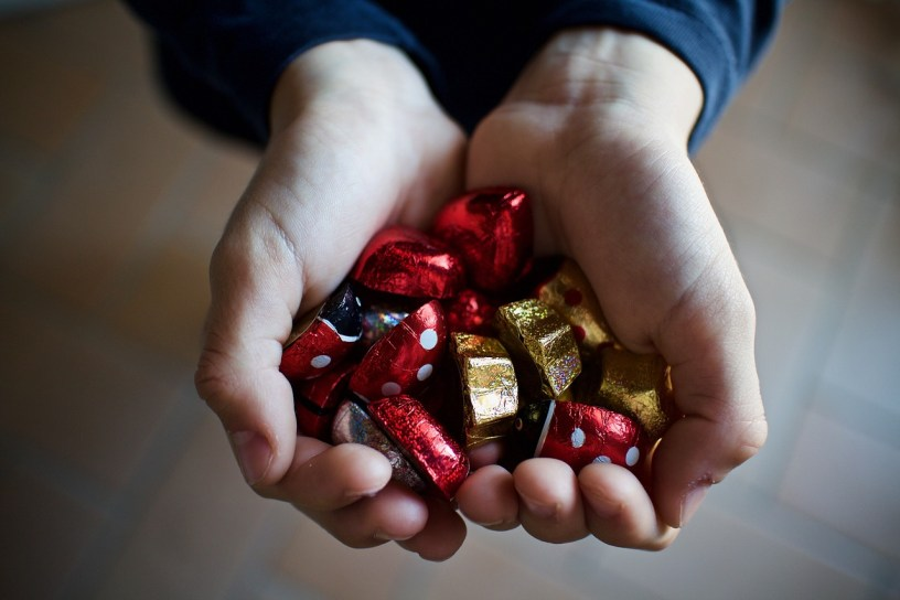 wrapped chocolates in hands