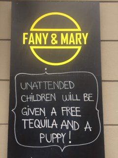 a sign in front of Fany and Mary