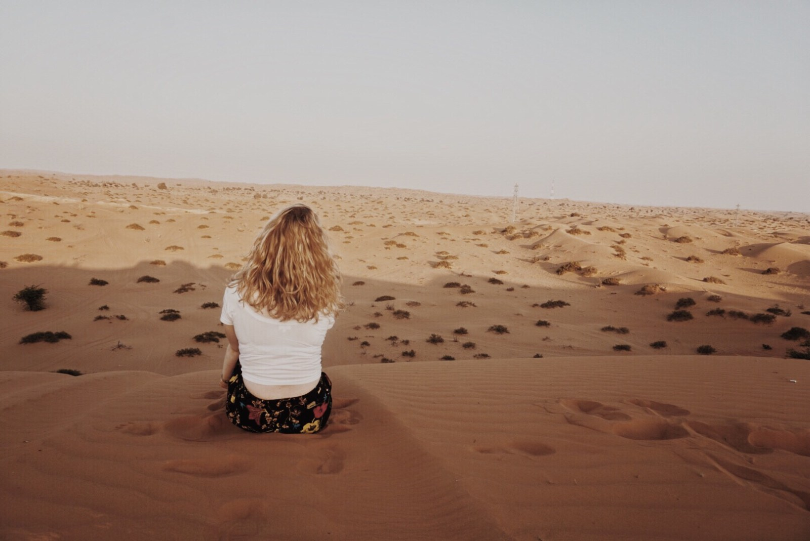 girl sitting in the desert