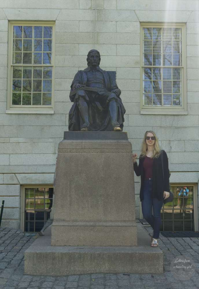 Statue of founder of Harvard and me standing next to it