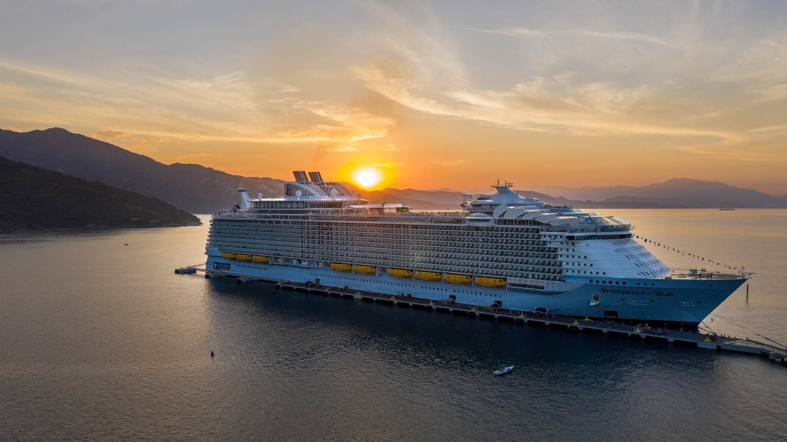 cruise ship going away in the sunset