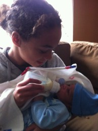 Ravyn holding Malachi for the first time