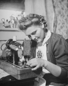 Girl working at sewing machine
