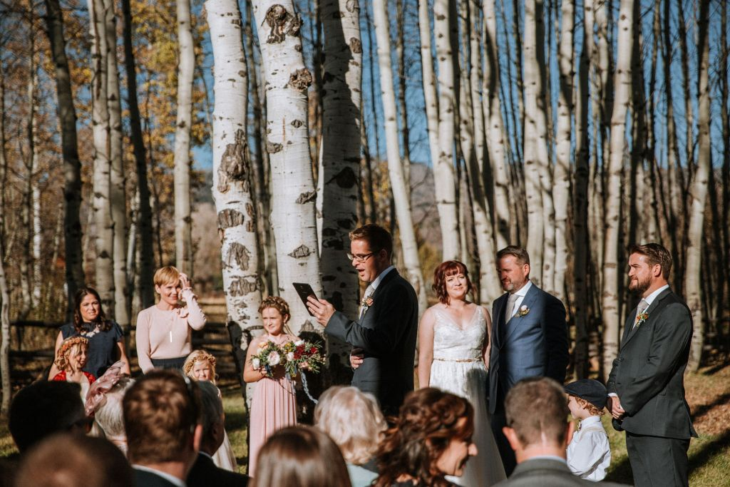 Wedding party supports couple marrying themselves in Colorado