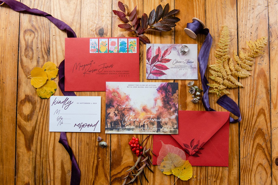 Wedding invitation suite for fall wedding featuring fall colors and leaves