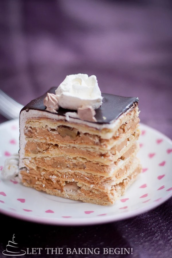 Markiza Cake is a popular Russian Cake that consists of thin layers of shortbread, meringue, walnuts and Dulce de Leche Buttercream. It's one of the most well loved cakes in my family and they request it, all the time! Try it and you'll see why!