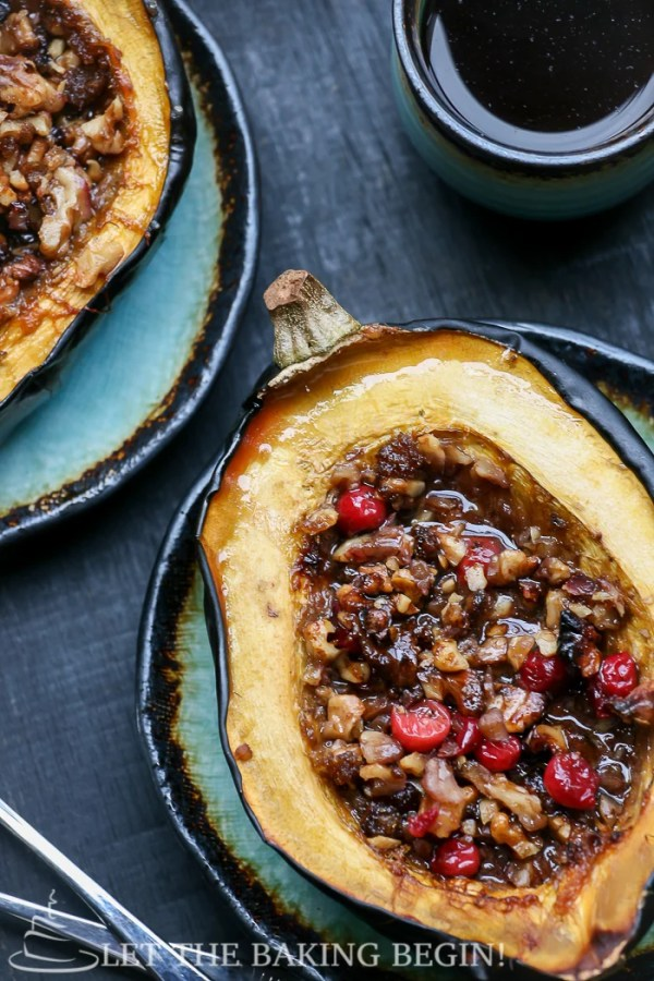 Acorn Squash with Walnuts & Cranberry is baked with brown sugar until tenderly soft. This Stuffed Squash is a perfect, clean and healthy fall dessert that will become your instant favorite like it has for us!