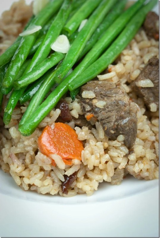 Beef Plov with Green Beans is comfort food at it's finest. Fluffy rice is cooked with chunks of tender beef infusing each grain with the most amazing flavor.