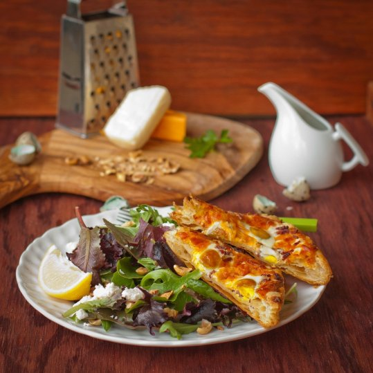 Egg Tart and Green Salad w/ Walnuts and Honey Mustard Dressing on a plate.