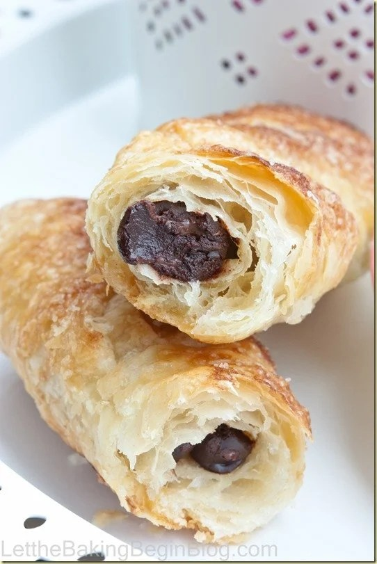 Close up picture of croissant filled with chocolate creme.