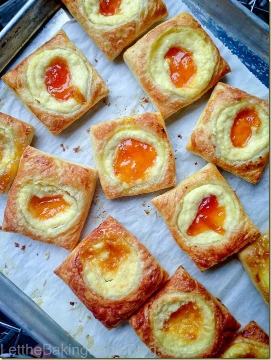 Top view of pastries on a parchment lined baking sheet.