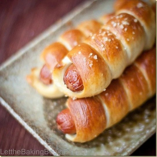 Pretzel Dogs - Chewy dough of the pretzel, slightly sprinkled with coarse salt and all lovingly wrapping the juicy sausage makes for a delicious lunch for kids and adults alike! | by LettheBakingBeginBlog.com | @letbakingbegin