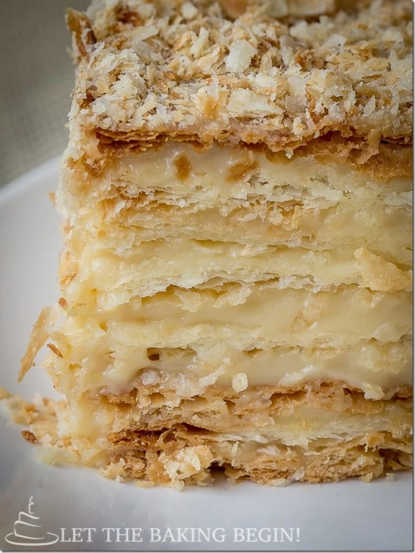 A slice of the ultimate Russian napoleon cake recipe on a plate.