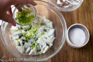 Refreshingly simple & delicious salad of Cucumbers, Dill & Creamy low-fat dressing that goes perfectly with any grilled meat or fish. by LetTheBakingBeginBlog.com