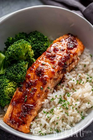 Honey Glazed Salmon on top of rice with a side of broccoli in a bowl.