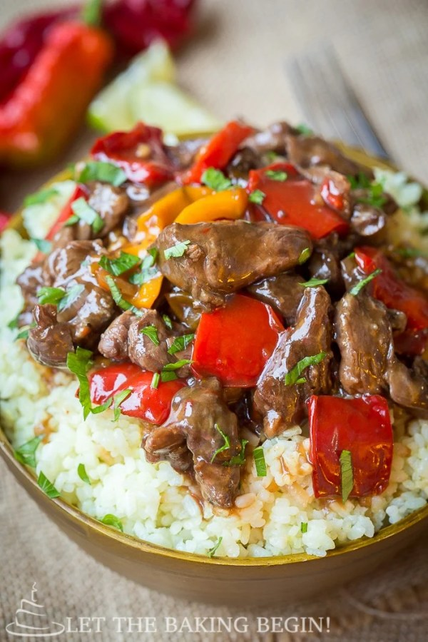 Up close picture of spicy slow cooker beef & bell pepper in a bowl with rice.
