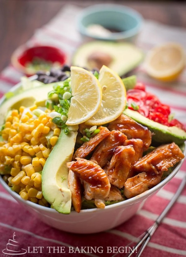 Copycat Cheesecake Factory BBQ Ranch Chicken Salad in a bowl topped with two lemons.