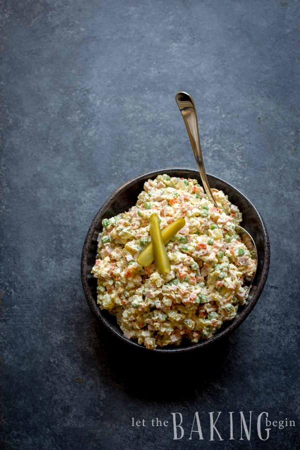 Fancy version of a Potato Salad, this Olivier Salad is made better with the addition of smoked sausage and herbs.