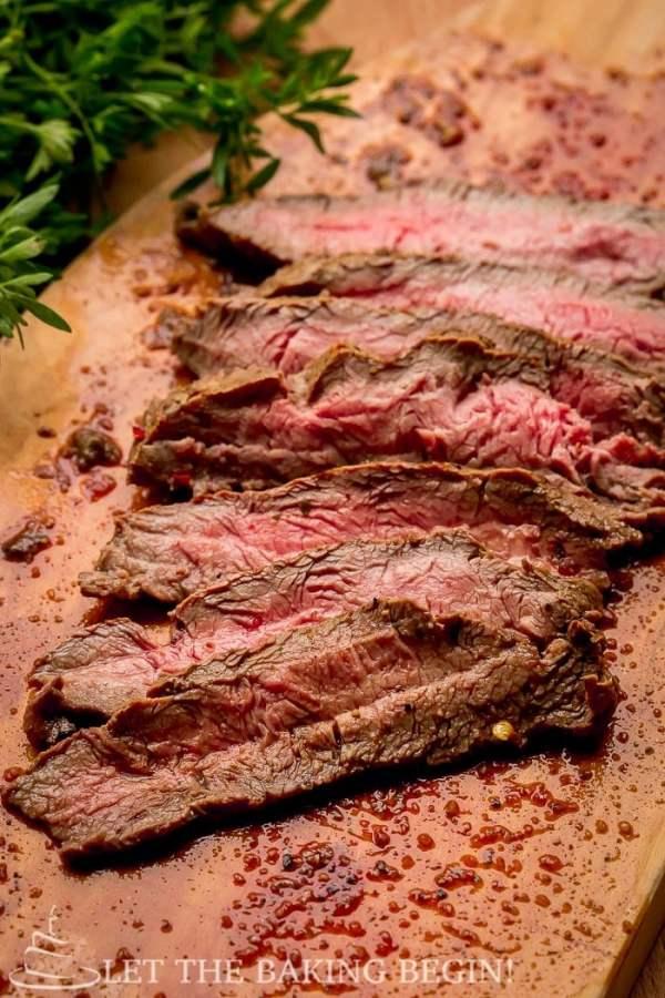 Steak slice on a cutting board.