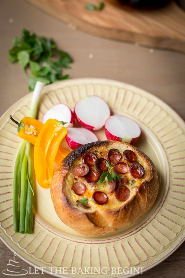 Egg and Sausage Stuffed Breakfast Boats - an easy-peasy breakfast that is filled with all things delicious – cheese, sausage and egg. By LetTheBakingBeginBlog.com   @Letthebakingbgn