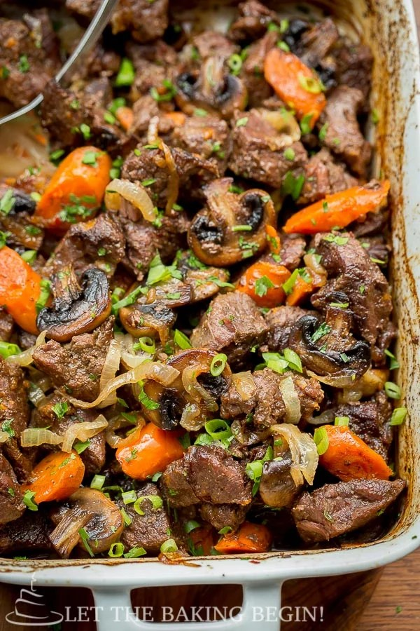 Beef with Caramelized Onions and Mushrooms in a casserole dish.
