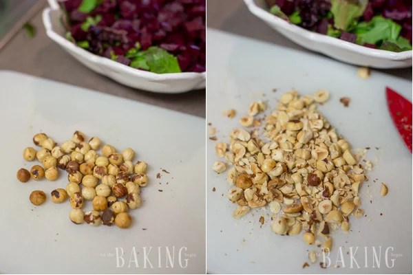 How to finely chop hazelnuts on a cutting board.