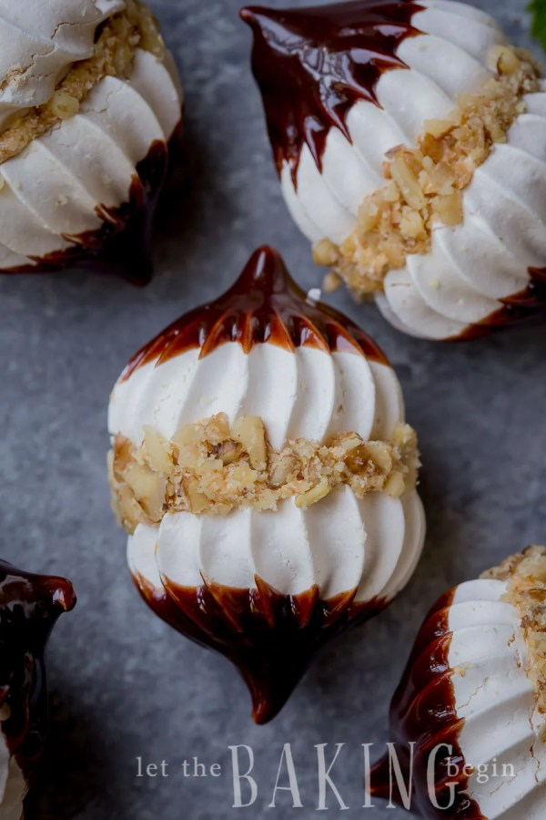 Hazelnut Meringue Bombs covered in chopped hazelnuts and dipped in ganache.