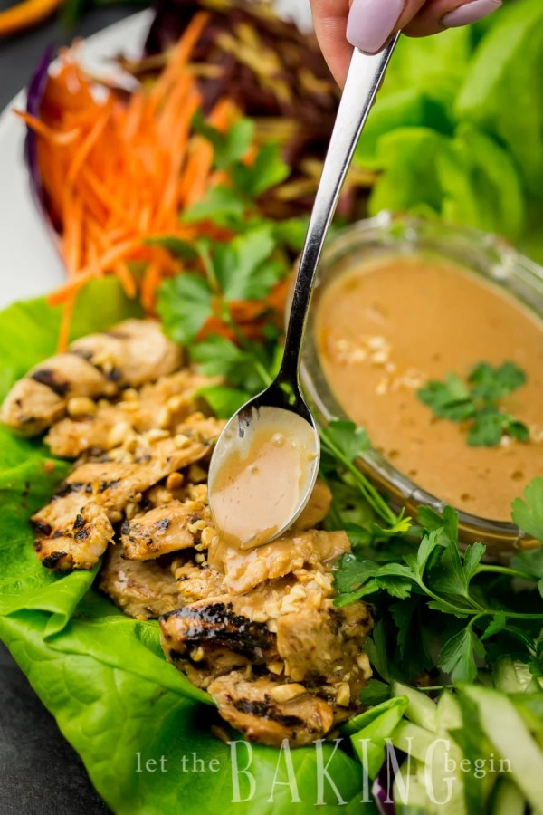 Lettuce wraps on a plate with Thai chicken and a homemade peanut sauce.