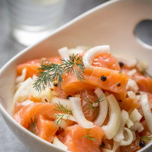 Cured Salmon is a cross between a lox and gralvax. It is brined in a salty-sweet brine with spices and eaten in chunks with a hot baked potato.