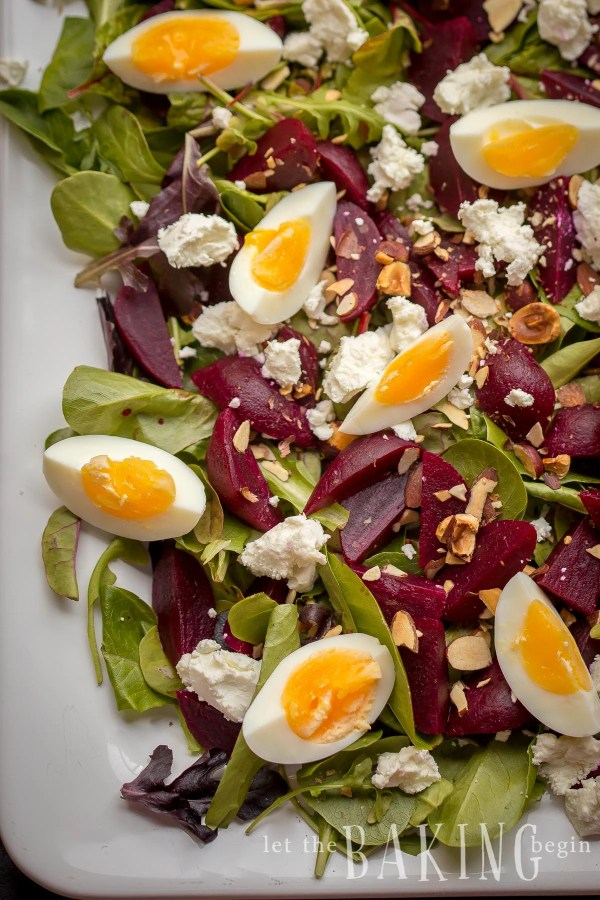 Beet and Goat Cheese Salad with Egg is served on a bed of Spring Mix Salad, then sprinkled with Goat Cheese, Hazelnuts, and finally drizzled with Honey Balsamic Vinaigrette. It is simple, healthy, hearty and delicious!