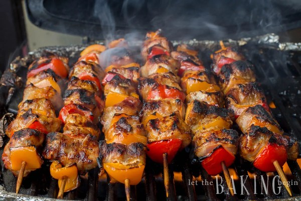 Bacon Wrapped Pork Kabobs - Juicy Kabobs are made even more amazing with the addition of smoky bacon. They're perfect for a summer picnic BBQ. Even you'll be surprised at the amount of flavor packed into these Grilled Kabobs!