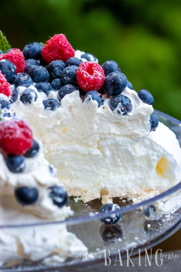 Pavlova Cake is light as air, fluffy as the softest pillow, absolutely delightful meringue dessert that combines, marshmallowy pavlova cake, fluffy whipped cream and berries that come together into a delicious and simple dessert.