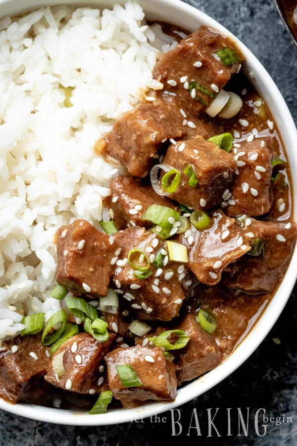 Instant Pot Korean Beef and Rice is perfect for a busy weeknight dinner. The notes of ginger and garlic give this tender beef recipe that Asian flavor flare that my family absolutely loves! Forget takeout and make this at home instead!