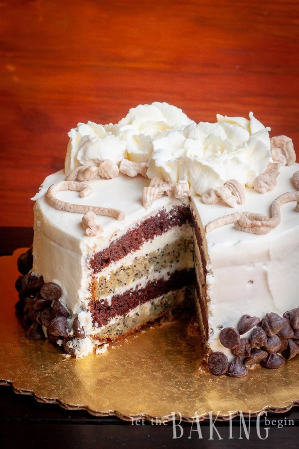 This popular Russian cake is made with Chocolate and Poppy Cake layers and filled with sweetened condensed milk buttercream and covered with light whipped cream.