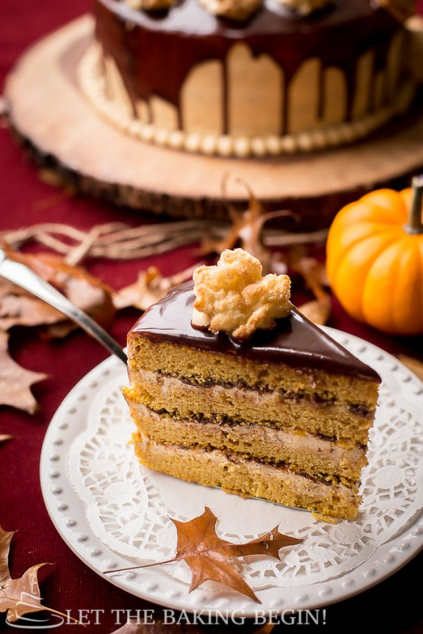 Layered Pumpkin Cake slice with Cream Cheese Dulce de Leche Buttercream on a plate.