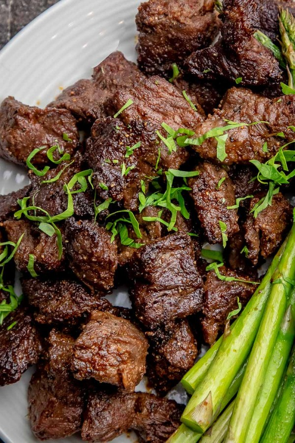 Beef Steak Tips sprinkled with parsley.