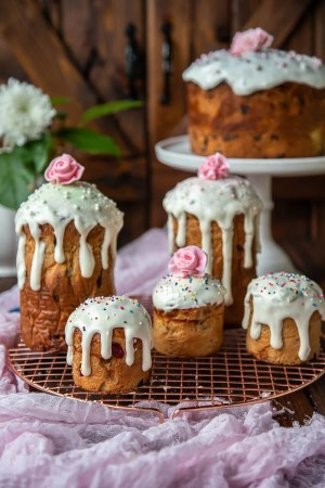 Paska Easter Bread is made with brioche-like dough, filled with plump rum-soaked raisins and topped with sweet and beautiful glaze.