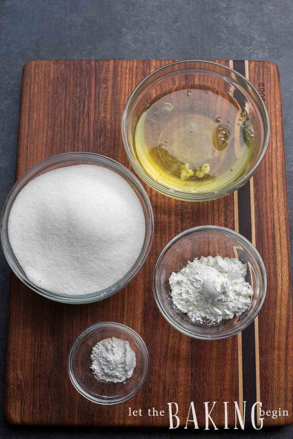 Ingredients for a pavlova recipe such as egg white, sugar, cornstarch and cream of tartar
