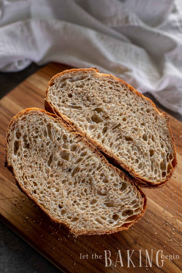 No knead bread recipe cooked and cut in half showing airy center