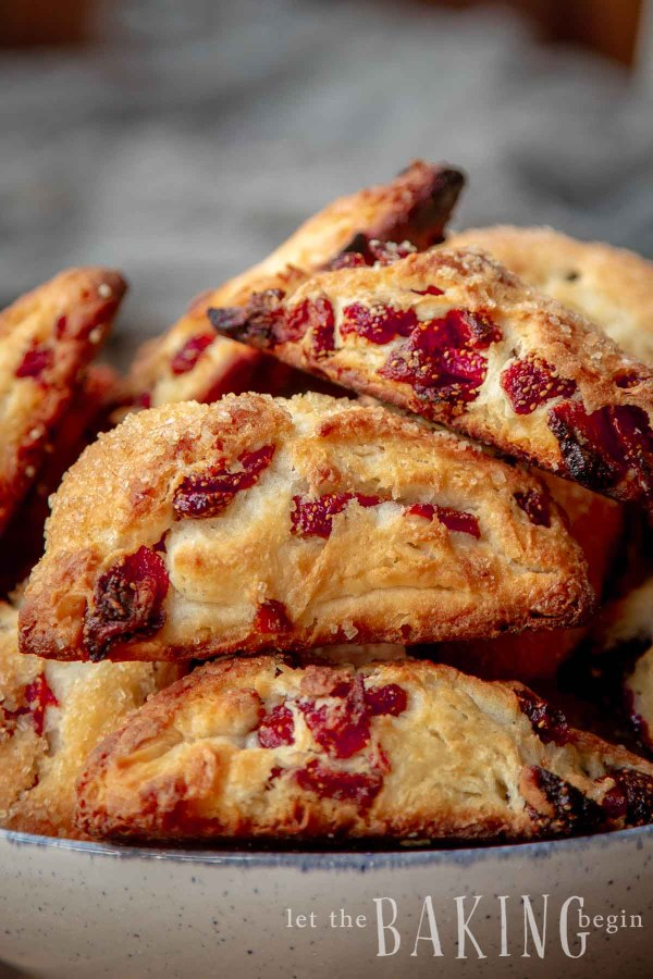 Close up of a stack of strawberry scones in a bowl