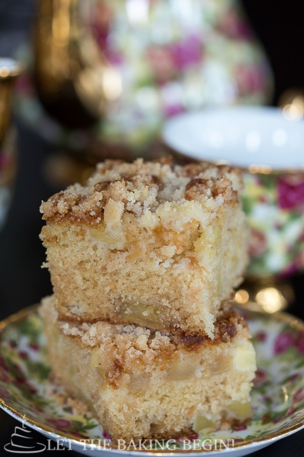 Apple Coffee Cake w/ Streusel Topping - Apples make any baked thing very moist, as they continue giving off the moisture into the cake long after they are baked, not only keeping it very moist but also keeping it from going stale longer. The Streusel Topping gives this cake of a crunch and caramel flavor. by LetTheBakingBeginBlog.com