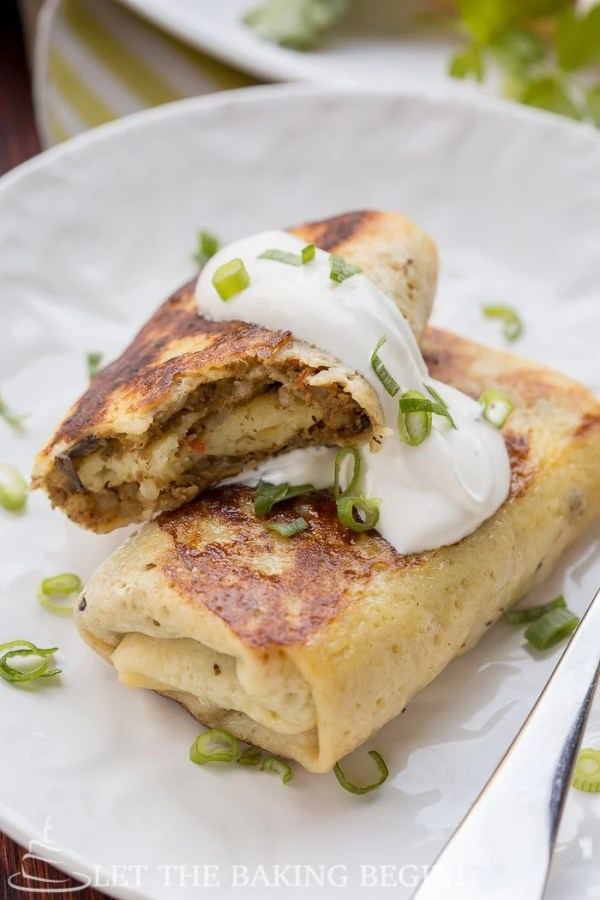 Savory Crepes - Delicious crepes filled with beef & mushroom filling. They're great as a make ahead or freezer meal. Make them for breakfast, lunch, or dinner - they will be a hit any time of day! by LetTheBakingBeginBlog.com | @Letthebakingbgn